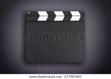 Blank movie clapper board with vignette - stock photo