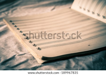 Blank musical composition sheet music with vintage tone - stock photo