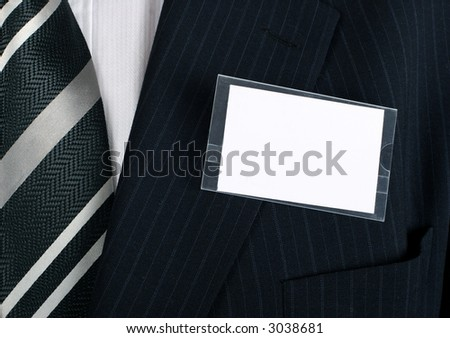 Blank namebadge on a well dressed businessman - insert your own brand and information - stock photo