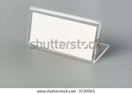 Blank nameplate on grey desk or table. Concepts of identity, identification. - stock photo