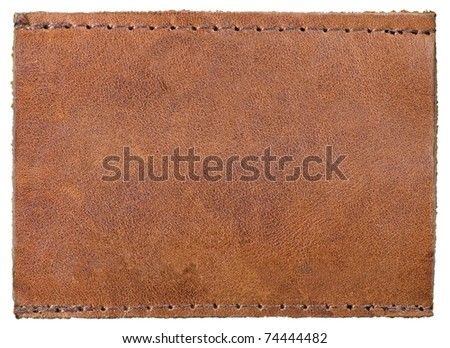 Blank Natural Leather Label Jeans Tag, Isolated Rustic Macro Background - stock photo