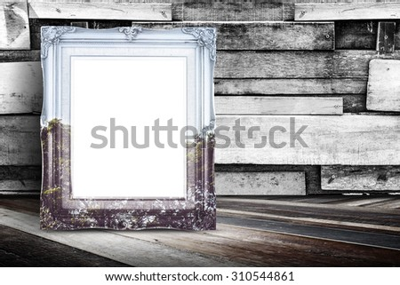 Blank nature overlay vintage photo frame leaning at plank wood wall and diagonal wood floor,Mock up for adding your design. - stock photo
