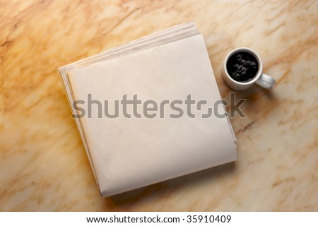 Blank newspaper and cup of coffee on marble surface. Add your own copy. - stock photo