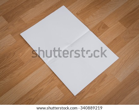 Blank Newspaper with empty space mock up on wood background - stock photo