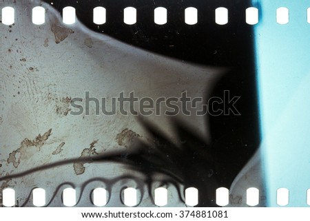 Blank noisy grungy scratched film strip texture background  - stock photo