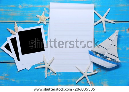 Blank note  and blank poraloid on wooden planks for summer  - stock photo