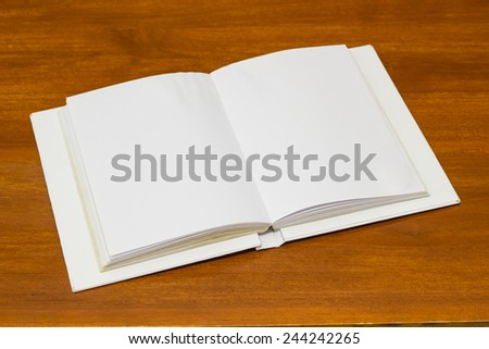 Blank note book paper on wood floor