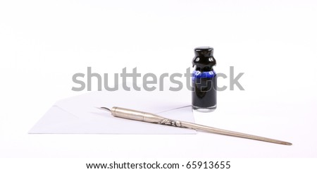 Blank note card with envelope, old-fashioned dip pen and inkwell containing blue ink on a white background