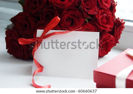 Blank note for message over bunch of red roses - stock photo