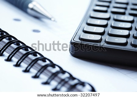 Blank note pad and a calculator
