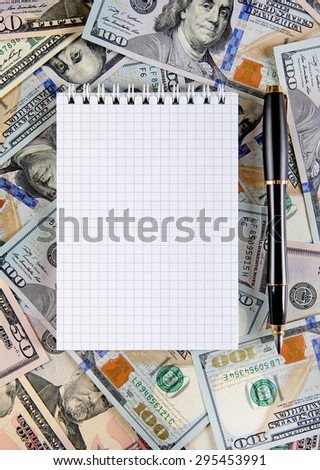 Blank Note Pad and Pen on the American Dollars Background - stock photo