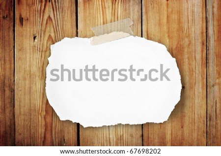 blank note paper attach on old wooden background - stock photo