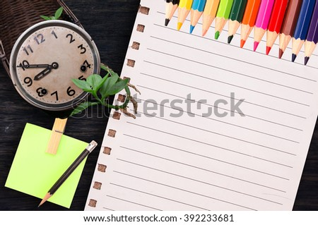 blank note paper, coffee, clock on wood desk top view. empty space for text. selective focus. - stock photo