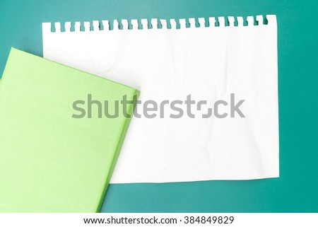 Blank note paper crumpled with green background - stock photo
