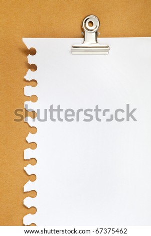 blank note paper on cardboard background with clip - stock photo