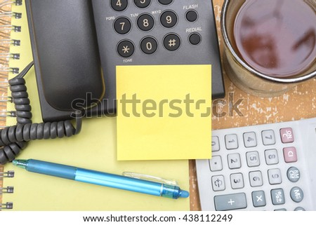 blank note paper stick on telephone on the table - stock photo