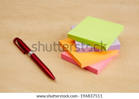 Blank note paper with ballpoint pen on the desk