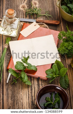 Blank note paper with fresh herbs - stock photo