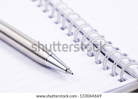 Blank note paper with silver pen - stock photo