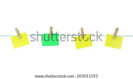 Blank note papers hanging with wood pegs on clothesline - stock photo