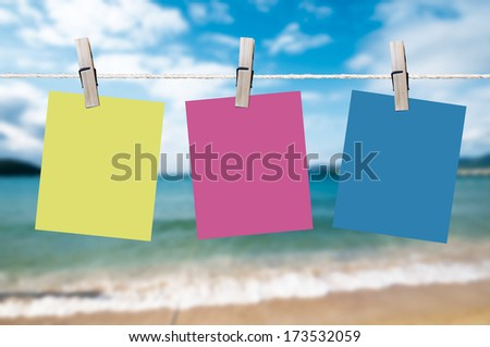 blank note papers in blue backgroun