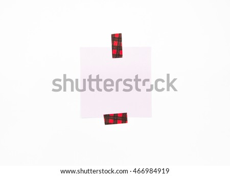 Blank note with pattern tape isolated on white background with soft shadow.