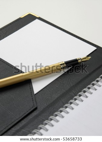 blank note with  pen  on the plain background - stock photo