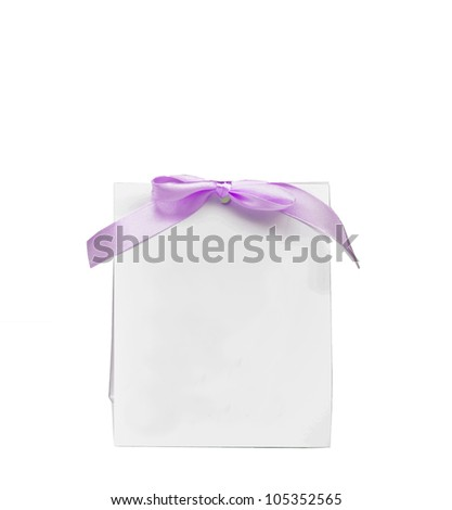 Blank note with puple bow isolated on white - stock photo