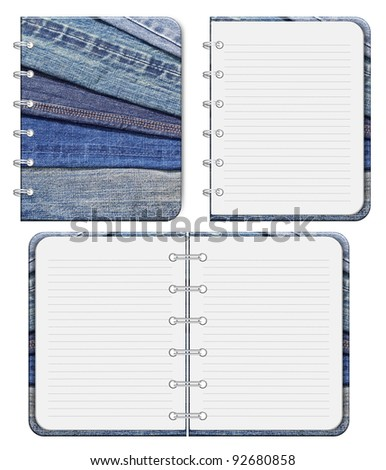 blank notebook and blue jeans Front cover.  isolated on white background