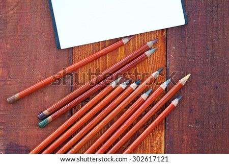Blank Notebook and Colorful Pencils - stock photo
