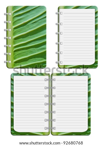blank notebook and green leaf Front cover.  isolated on white background