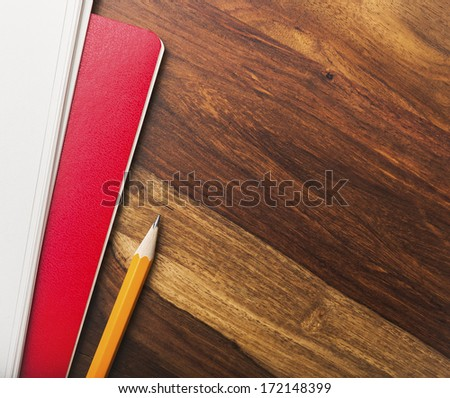 Blank notebook and papers - stock photo