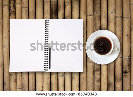 blank notebook coffee cup on bamboo background