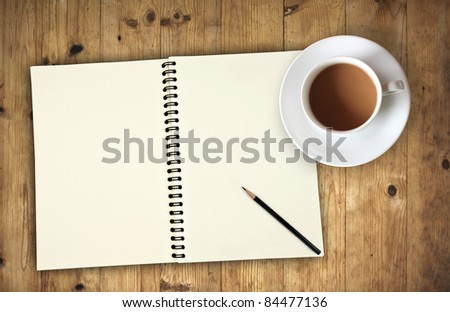blank notebook coffee cup on wooden background