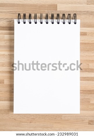 Blank notebook for painting, drawing and sketching on wooden texture background.