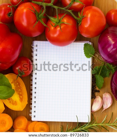 blank notebook for recipes with colorful vegetables - stock photo