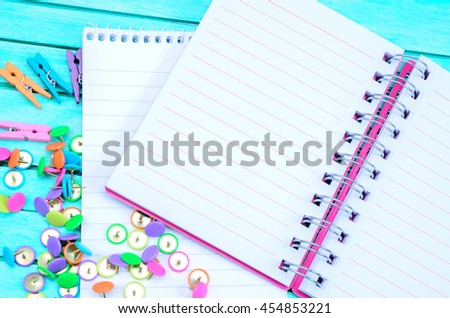 blank notebook on blue wooden table