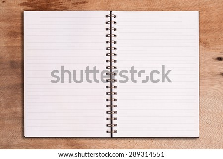 blank notebook on wooden table.