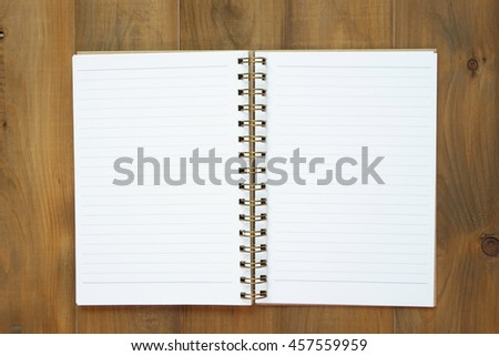 blank notebook on wooden table, business concept