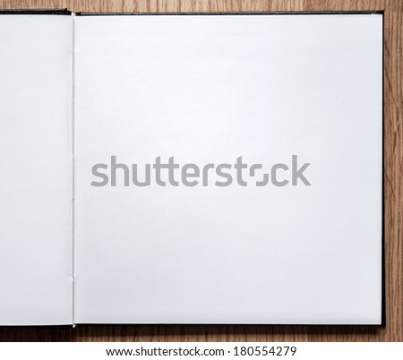 Blank notebook opened on wood background 1 - stock photo