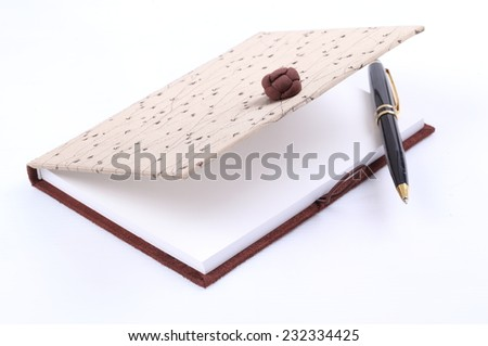 Blank notebook with black pen isolated on white - stock photo