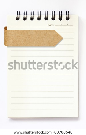 blank notebook with blank recycle paper label on white background - stock photo