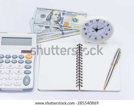 Blank notebook with clock and calculator for business concept - stock photo