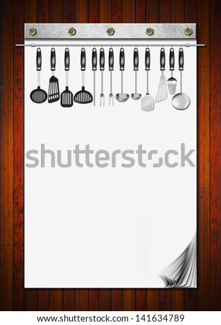 Blank Notebook with Kitchen Utensils / Notebook with blank pages and kitchen utensils for recipes or menu on wooden wall  - stock photo