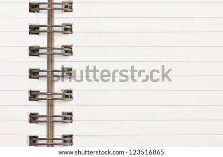 Blank notebook with metallic ring binder. - stock photo