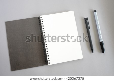 blank notebook with pen   - stock photo