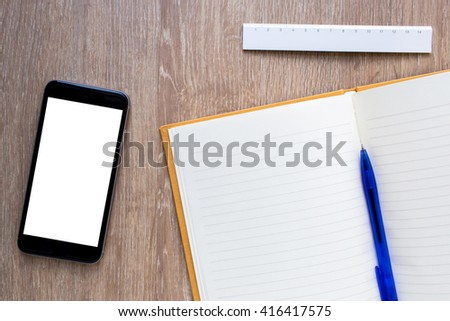 blank notebook with pen, smart phone and ruler on wooden background - stock photo