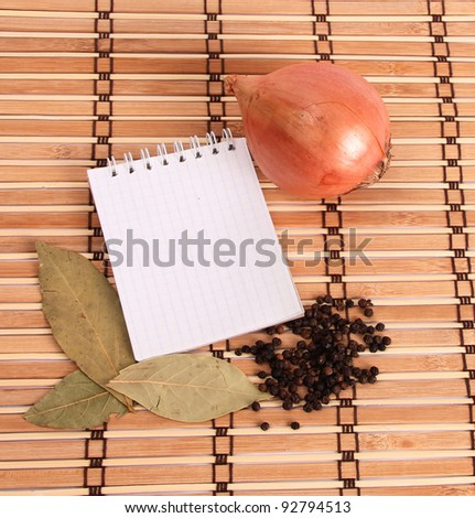 Blank notebook with spices on wooden background - stock photo