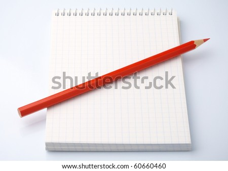 Blank notepad and red pencil as an organizer - stock photo