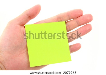 blank notepaper stick on hand with white background